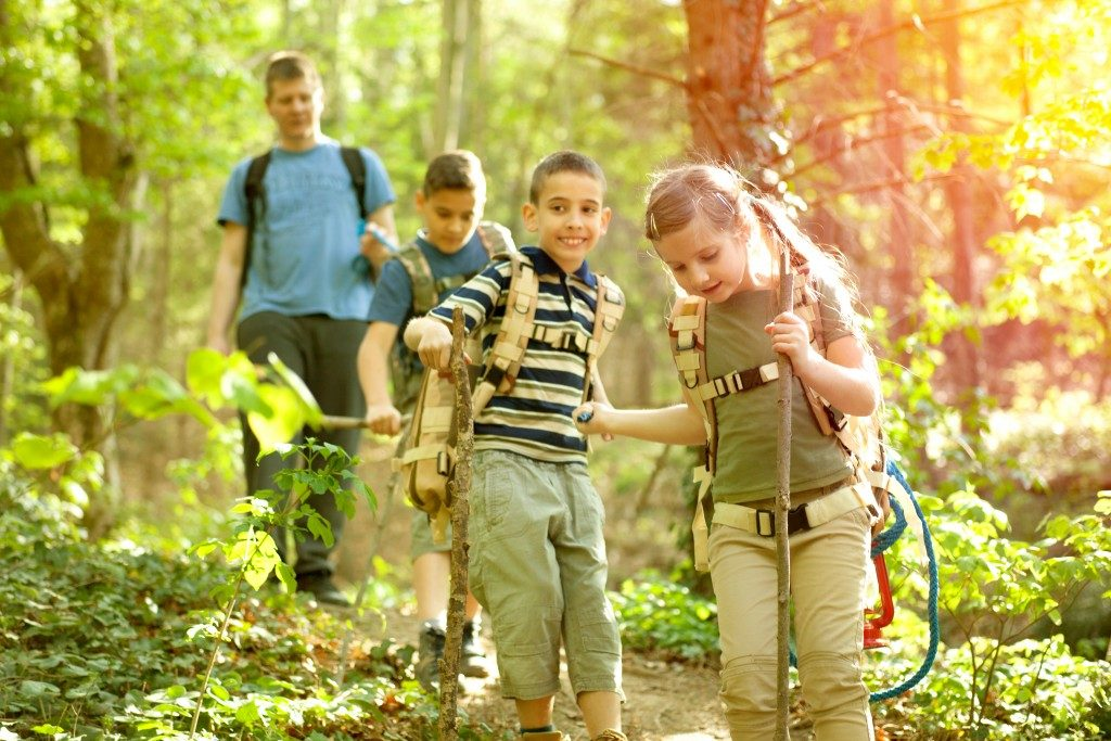 kids trekking during summer camp