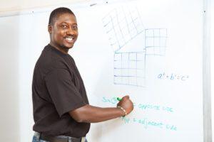 Man writing on a whiteboard
