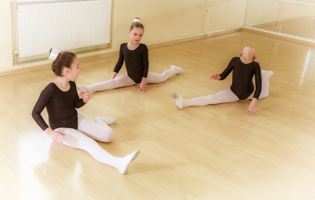 Kids stretching before ballet lessons