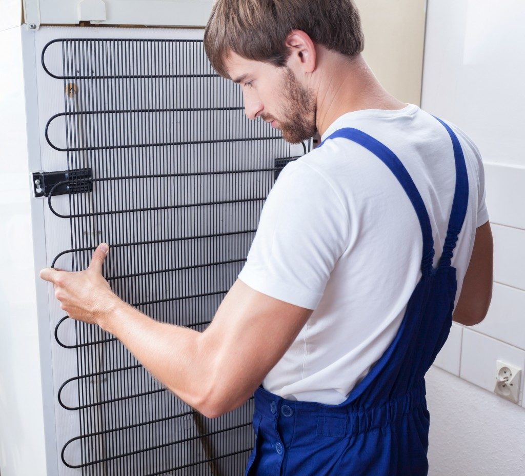 man installing fridge