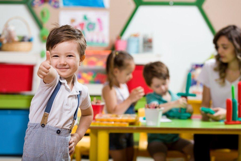 preschool student giving thumbs up