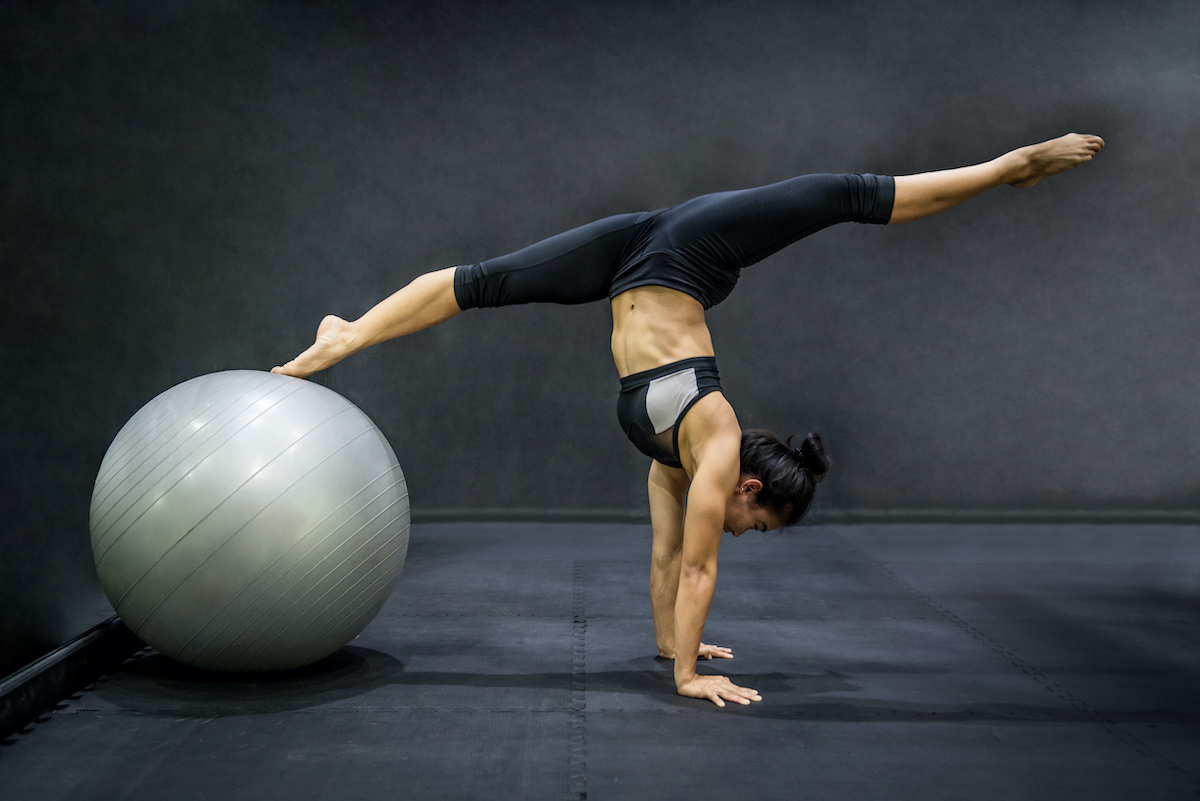 flexible woman with exercise ball