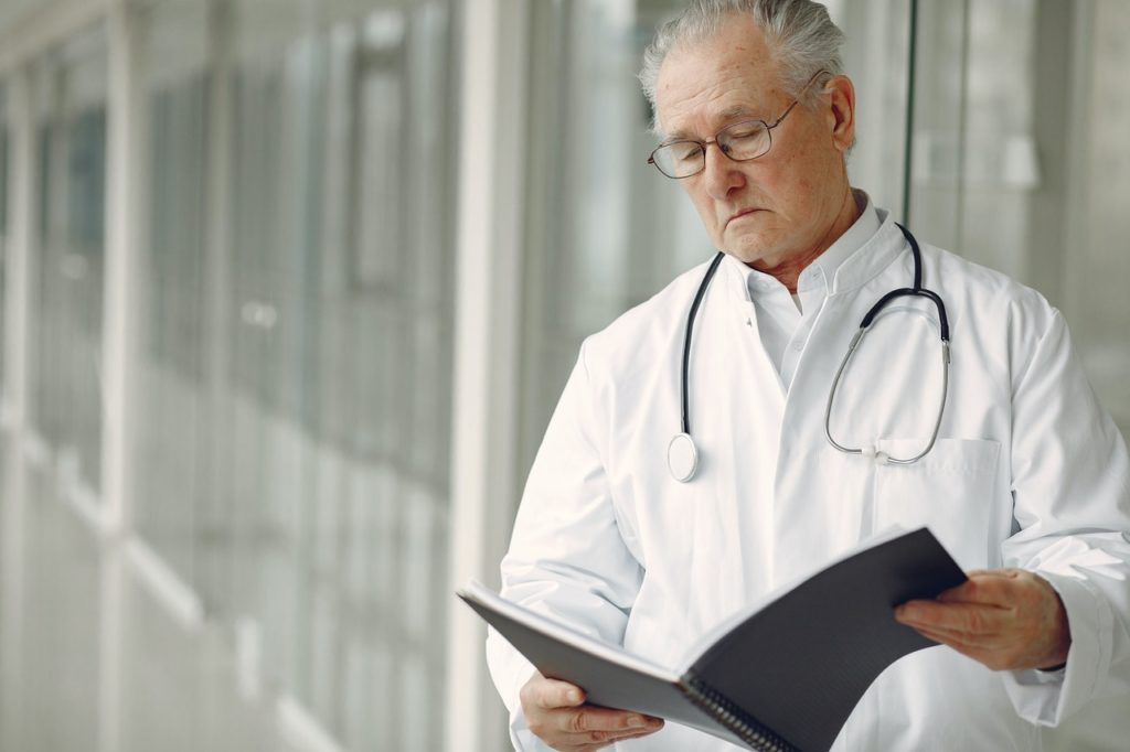 doctor reading documents